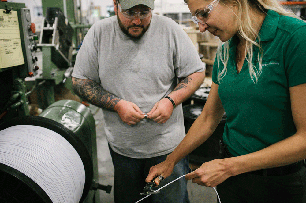 Two Northwire engineers working on custom cable solutions in a factory